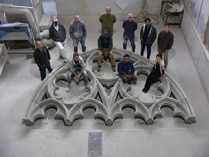 Team photo inside west front tracery window